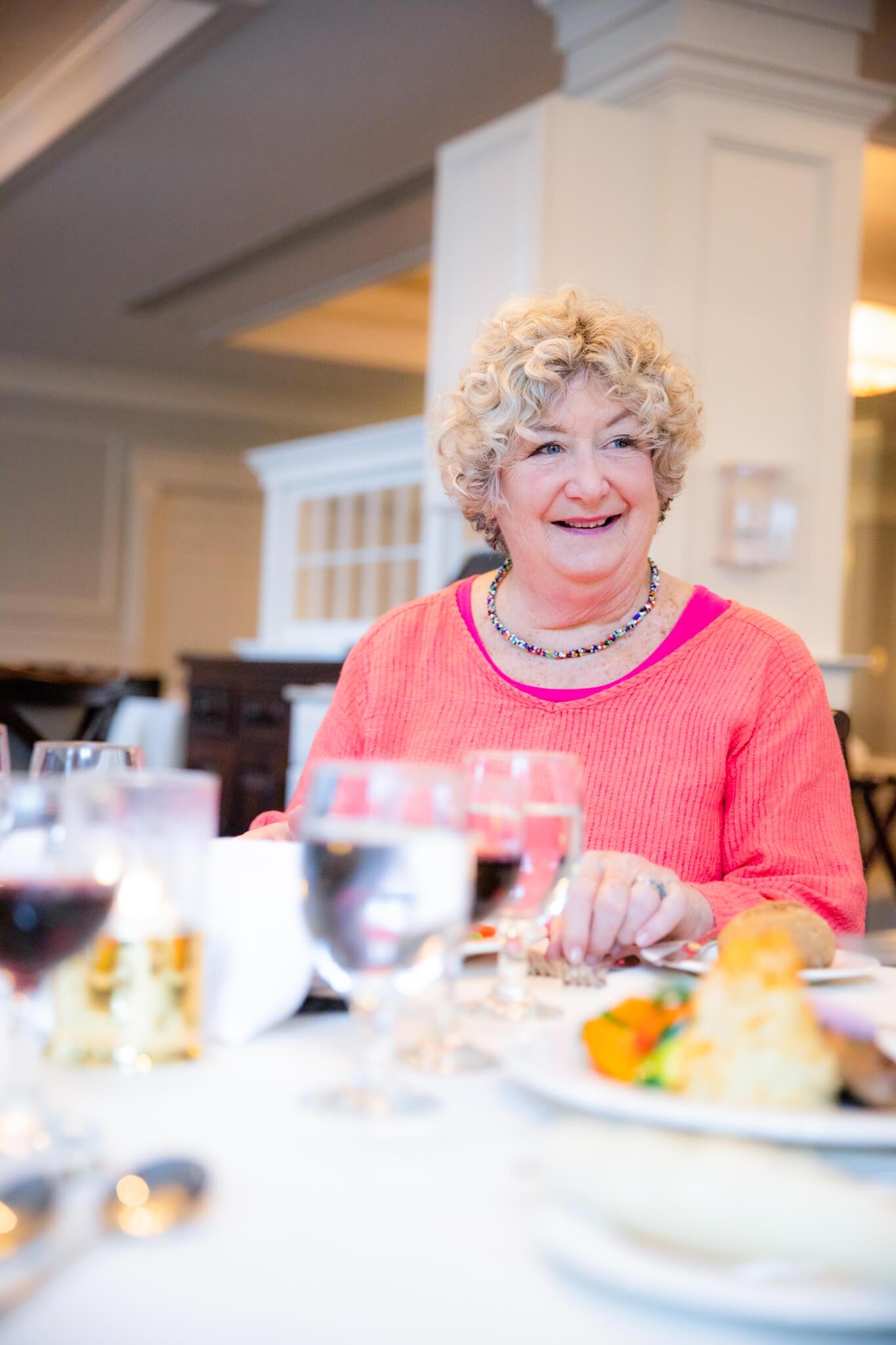 Lynn Stroud Sitting at a Dinner Table
