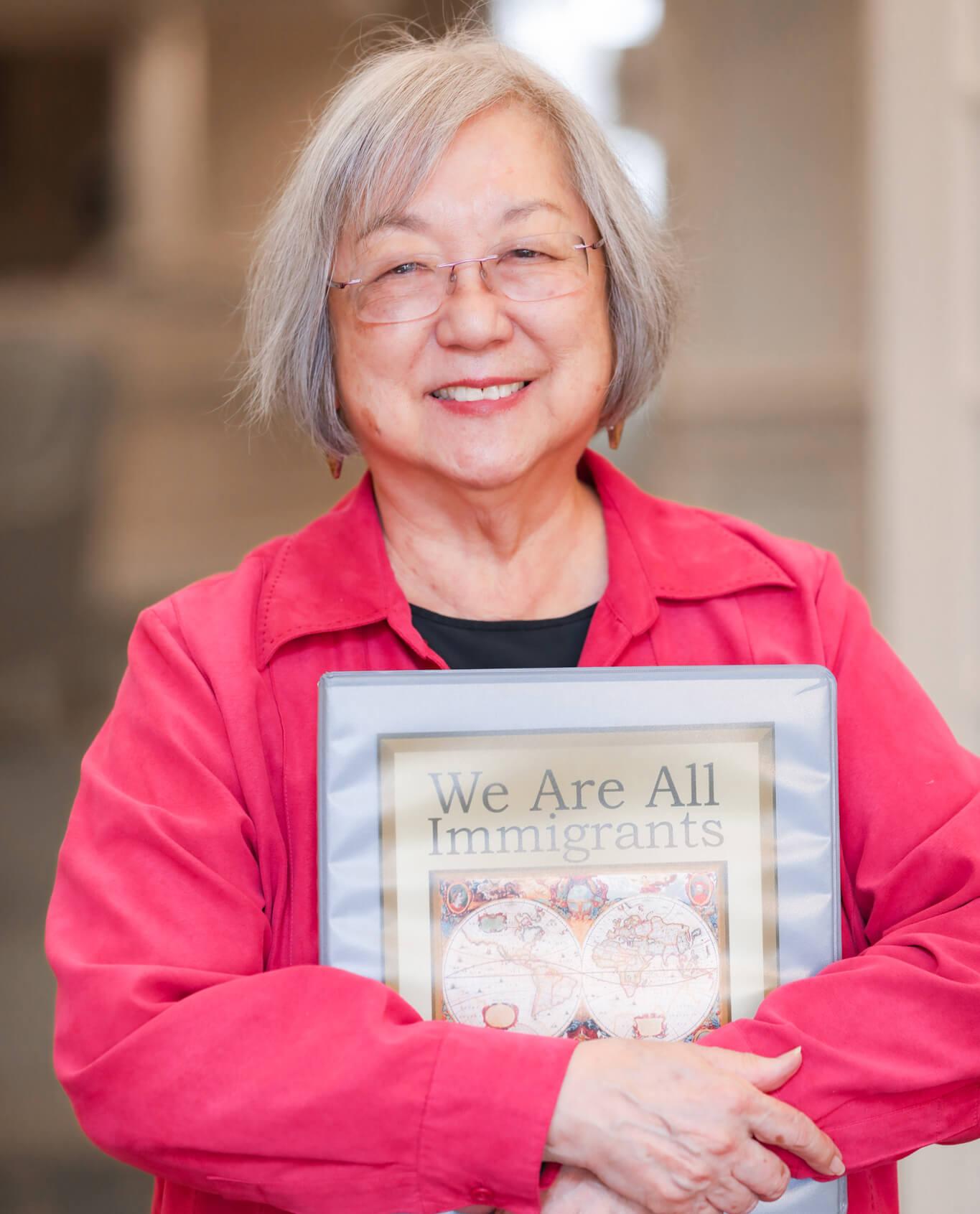 Margie Yamamoto Holding A Book