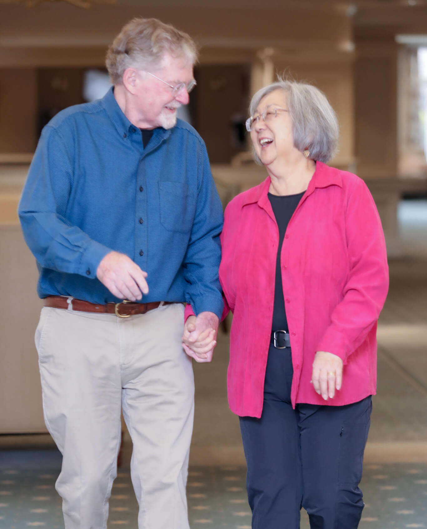 Margie Yamamoto and Mark Hopkins Holding Hands and Laughing