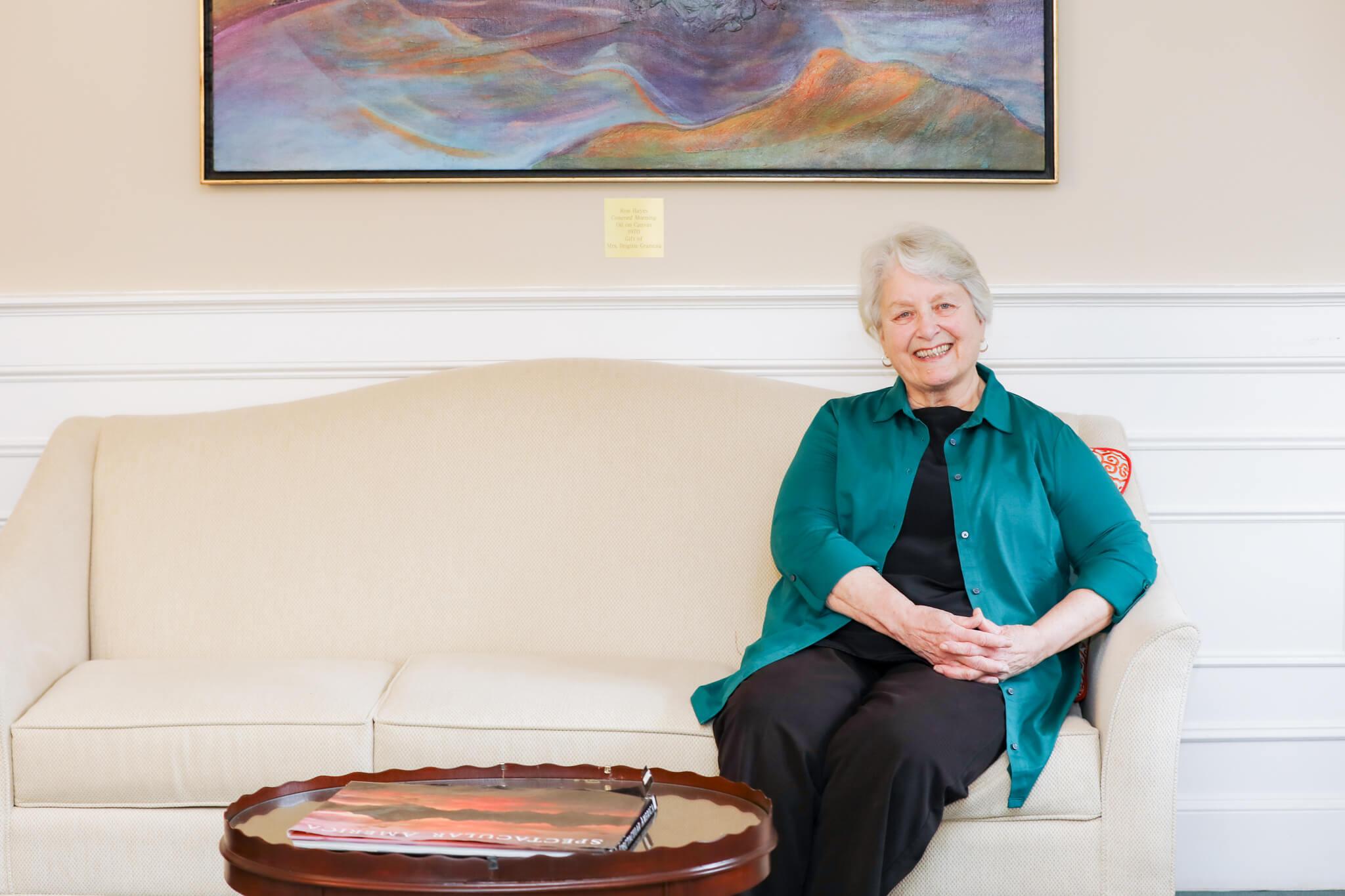 Marcia Bradley Sitting on Couch