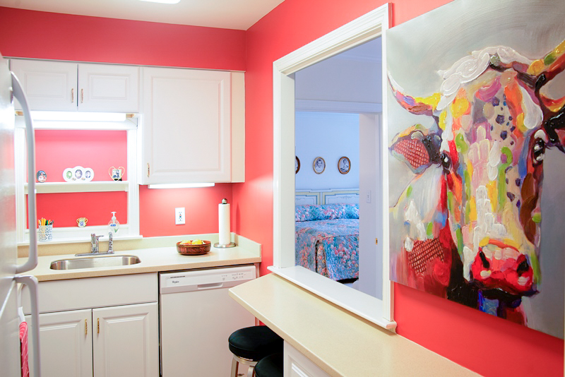 Pink Kitchen with Cow Painting