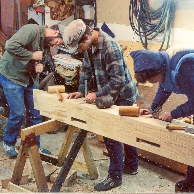 Group of Men Carving a Beam