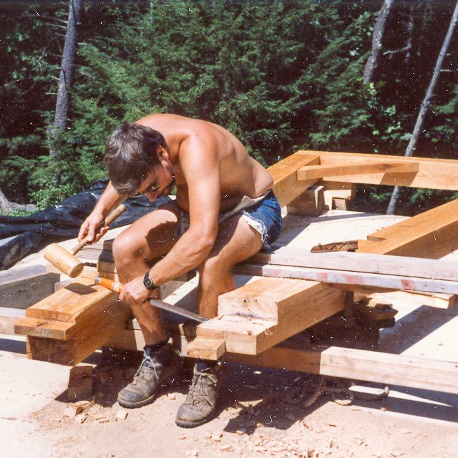 Ted Carvalho Carving a Beam