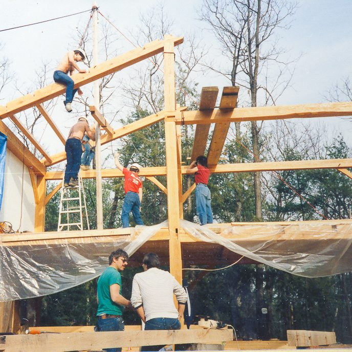 Group of People Constructing a House